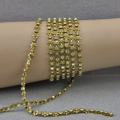4 Foot Strand of Brass Flower Peridot Rhinestone Chain 3 and 5 MM Alternating Flower Petals by oscarcrow on Etsy