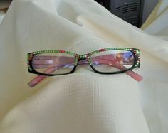 Check out Hand designed Swarovski Crystal 1.25 Reading Glasses. Green frame, Swirls of Pink, Purple on the Arms, Peridot and Pink Crystals on jamaartbeads