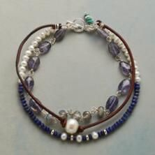 A lovely luminescence wends about your wrist with this pearl and gemstone, sterling silver toggle bracelet.
