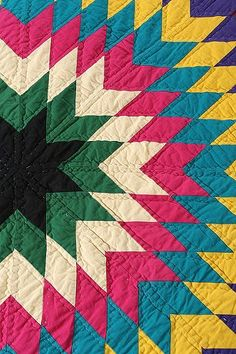 Graphic Bold Colors on this Starburst Quilt