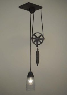 A great pulley lamp for any industrial or rustic home decor. Pulley Pendant Light, Vintage Industrial Lighting, Industrial Style, Industrial Design, Décor Antique, Deco Originale, Original Vintage, Table Design, Ball Jars