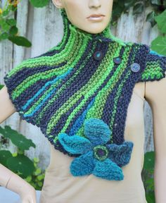 Knited Scarf - Capelet. Unique scarf made . Warm and pleasant to the touch. Beautiful unique design. Color: shadows green blue, grey, turquoise  Size: One size fits all 75/33cm 29,53/12,99  materials used: wool, acrylic, button  Care instruction: hand wash using warm water.   Because of different monitors and screen resolutions, colors may look different on the screen than really.