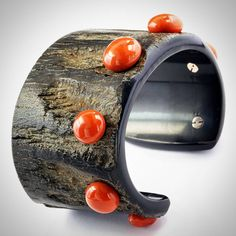 Buffalo horn and coral cuff by Taffin