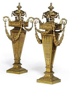 A PAIR OF GILT-BRONZE TABLE ORNAMENTS <br />OF GEORGE III STYLE, LATE 19TH CENTURY <br />Each with fluted tapering stem with urn finial and swag hung sides <br />18½ in. (47 cm.) high (2)<br />