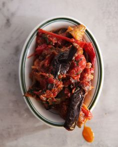 End-of-summer zucchini, eggplant, peppers, and tomatoes are subtly flavored with herbes de Provence in this classic French dish.