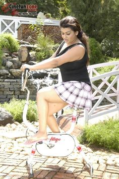 Hot Sona on exercise cycle | Latest spicy stills from movie sokkali | Indian Masala blog