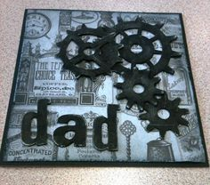 Dad card using Tim Holtz Sizzix gadget gears and word play dies, black acrylic paint and chronology papers