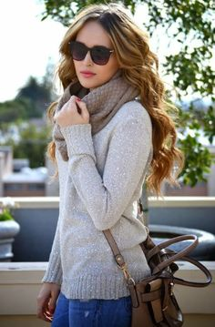 Stylish leather bag,sweater,knit scarf,blue jeans and fashionable glasses