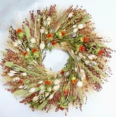 Product Comparison: For The Birds Wreath 18 in VS Vintage Wheel Wreath 22 in Dried Flower Arrangements, Silk Floral Arrangements, Dried Flower Wreaths, Dried Flowers, Broom Corn, Vintage Wreath, Silk Plants, Summer Wreath, Door Wreaths