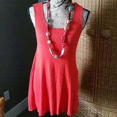 Free people orange tunic top Cute orange ribbed sleeveless tunic top.  Full and long, great by itself or with your favorite tank underneath. Free People Tops Tunics