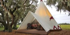 Canvas Teepee tent under huge, shady oak trees. Westgate River Ranch Resort and Ranch