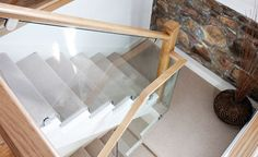 This stunning cut string glass and oak staircase is handcrafted and finished to the highest quality and uses brushed steel clamps to hold secure the glass. Staircase Bookshelf, New Staircase, Loft Stairs, House Stairs, Carpet Stairs, Staircase Design, Staircase Ideas, Glass Bannister, Glass Stairs
