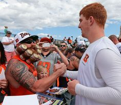 BENGAL BEARD Cincinnati Bengals quarterback Andy Dalton clasps hands with a fan after practice at the NFL football teams training camp, Sunday, July 28, 2013, in Cincinnati. (AP Photo/Al Behrman) MORE NFL TRAINING CAMP PHOTOS HERE