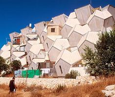 Zvi Hecker's Ramot Housing, Jerusalem...at 720 units. It was an exercise in using prefabricated components, at least in the first two of its five phases. With its crazy pentagonal design, the Ramot Polin Apartments resemble a housing project for honeybees.