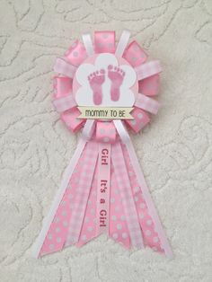 A personal favorite from my Etsy shop https://www.etsy.com/listing/264108896/mommy-to-be-ribbon-corsage-for-baby