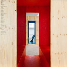 To make the video programmes in the public entrance hall visible and accessible, Ira Koers and Roelof Mulder designed half-open, freestanding cinemas: four intimate rooms with a monitor, a window and two benches with doorway-sized openings at either end.
