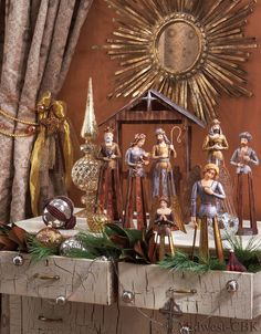 Casa Cristina Christmas Nativity by Midwest-CBK...I like how the drawers are pulled open and filled with Christmas decor