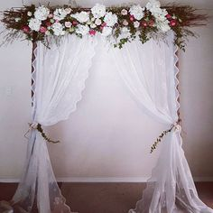 Vintage wedding backdrop with lace curtains and flowers. Ceremony decoration and styling. For all your Wedding hire needs Chairs, arches, aisle decorations. Specialising in Garden and Beach weddings- Victoria wide