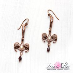 Copper wire wrapped earrings with garnet and freshwater pearls, gift for capricorn. $34.00, via Etsy.