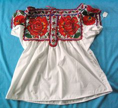 Chatino blouse with roses    big, red roses bloom on this Chatino blouse from Santiago Yaitepec, Oaxaca near Juquila