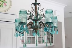 Great use of an old chandelier and mason jars