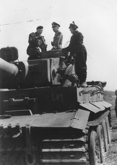 Heinrich Himmler with the crew of a Tiger Tank from 2nd SS Panzer Division.