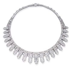 AN IMPORTANT ART DECO DIAMOND NECKLACE/'HALO' HEAD ORNAMENT, BY CARTIER Designed as graduated pavé-set diamond pierced panels with baguette-cut diamond spacers to the circular-cut diamond line and backchain, with fitting to convert to head ornament, circa 1935, 41.0 cm. long, with fitted red leather Cartier case Signed Cartier London, no. 324