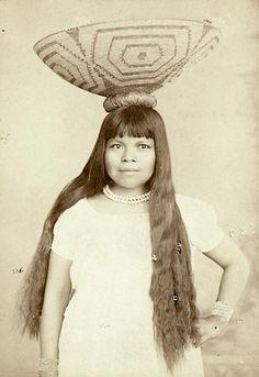 Mrs. Enos, a Pima woman with a basket. Gila River Pima-Maricopa Indian Reservation, Arizona. ca. 1880-1890. Source - Princeton Digital Library.