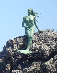 paper mache sculpture mermaid with the Antikythera mechanism