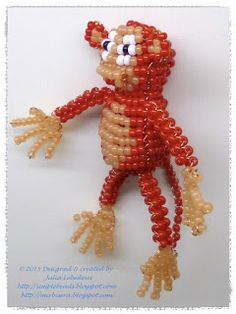 Monkey out of seed beads and wire in the technique of 3D beading. Free pattern with tutorial.