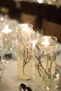 """I designed my winter wedding around the idea of snow filled forest, using natural pieces like twigs, bark, and fire to make it warm and cozy. The guests all commented on the warm and classic feel and the not-overly-obvious theme. My colours were champagne, navy and ivory. I am selling the majority of my decor; please see a list below:  Extra Large Vases (shown with flowers), including """"ice rock"""" and twigs, tulle optional: x8 [Diameter 6 ¼ """", Height: 26 ¾ """"]  $30.00 each or $225 for 8 // ..."""