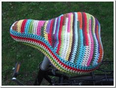 Crocheted bicycle seat cover.