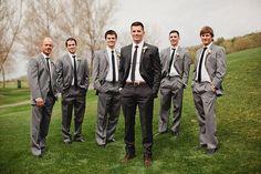 Groomsmen in light gray suits, groom in dark charcoal -- love it by ofelia