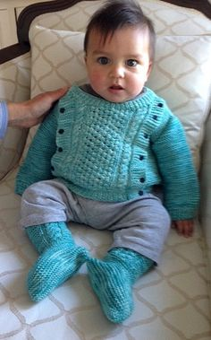 Free Knitting Pattern for Side Button Baby Sweater and Booties - Free for a limited time from Leisure Arts. Size:9-12 months. Designed by Marion Graham. Pictured project by hfholstine.  Go to the link and scroll down to get pattern. Pattern pic shows a white sweater. http://www.shareasale.com/r.cfm?u=1112880&b=146498&m=19565&afftrack=babysweater&urllink=www%2Eleisurearts%2Ecom%2Ffree%2Dpattern%2Dfriday%2Db%2Da