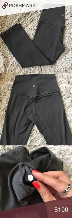 🍋Lululemon Align Crop II Dark Carbon 4 SOLD OUT COLOR! Great used condition, very small, barely noticeable pilling on the back from rubbing against something (pic 4) this color always sells out, hence the listed price. Price is firm for now. Pants feel like butter! Only selling because I've accumulated too many grey leggings! I usually wear a 2 in lulu, but these fit just fine on me. lululemon athletica Pants Leggings