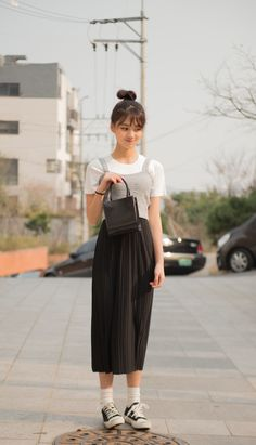 #mixxmix Black Pleated Midi Skirt (BWSF) This chic black piece boasts of textured pleats, a high waistline, and a modest mid-calf length. #mxm #hideandseek #has #365basic #bauhaus #99bunny#koreanfashionstyle #girlsfashion #lovelywoman #kstyle #koreangirls #streetfashion #twinlook #dailyoutfit #styling