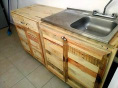 Now here you can see the reclaimed wood pallet kitchen cabinet placed on the ground, there is a drawer to store the cutlery or other small items of kitchen use. The spice bottles can be placed on the place with the door.