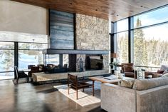 Stone clad + 3 sided fireplace + living room + timber ceilings