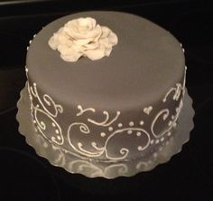 Royal Icing scroll work with gum paste rose