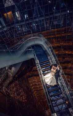 The atrium of Four Seasons Hotel Guangzhou makes a dramatic backdrop for a first kiss as newlyweds.