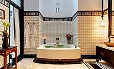 Serene art deco bathroom & flowers in Tub complete with two robes ;)