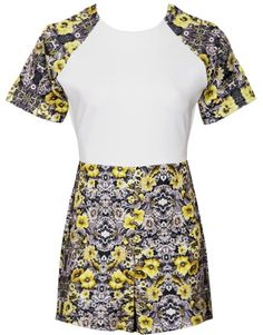Flower Bed Romper: Features a sharp white bodice bordered with vibrant floral print sleeves, invisible rear zip closure, and adorable romper shorts to finish.