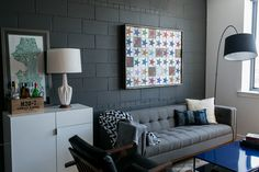 Pretty Cinder Blocks look Dc Metro Industrial Living Room Image Ideas with arc lamp bachelor pad black accent wall blue coffee table gray living rooom masculine