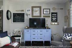 sherwin williams repose gray in a living room. Best gray paint color with navy blue accents