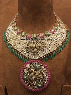 Grand polki diamond bridal necklace in brilliant design comprising ruby and emerald florets. Large round peacock pendant decked with small diamonds in black finish Indian Jewelry Sets, Royal Jewelry, India Jewelry, Gold Jewelry, Jewelery, Jewelry Design Earrings, Gold Jewellery Design, Diamond Jewellery, Bridal Jewellery
