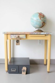 Check out the uplifting and sunny effect Arles Chalk Paint® decorative paint by Annie Sloan can have on a piece. Also used was Annie Sloan's Decoupage medium with a wonderful world map to give this sleek desk even more character!