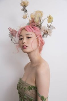 A beauty in the Dior Haute Couture collection by Maria Grazia Chiuri shown in Tokyo 19th April 2017. Faded silk roses…