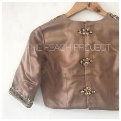 The Marshmallow Blouse is elegant AF we think! Blouse Neck Patterns, Saree Blouse Neck Designs, Designer Blouse Patterns, Latest Blouse Designs, Designer Saree Blouses, Work Blouse, Blouse Styles, Marshmallow, Indian Suits