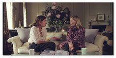 Kate Moss sits on the sofa in her own living room to chat to contributing editor to Vogue Kate Phelan. Love the set design and tall floral arrangement in the back.