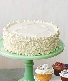 Yellow Cake With Vanilla Frosting and White Chocolate Chips | Need a sweet centerpiece for your holiday meal? Celebrate the season with these festive spring cakes.